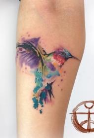 手臂水彩色飞溅蜂鸟纹身图片