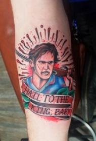 手臂上的拿枪的男子和英文横幅纹身图片