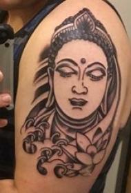 纹身佛像图 男生大臂上莲花和佛像纹身图片