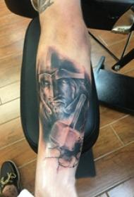 欧美小腿纹身 男生小腿上黑色的武士纹身图片