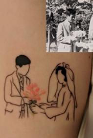 纹身照片 女生大臂上彩色的情侣结婚照纹身图片