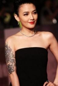 范晓萱的纹身  明星手臂上创意的龙纹身图片